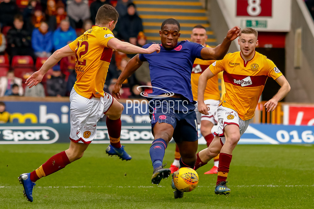 Uche Ikpeazu of Hearts gets a toe to the ball ahead of  Jake Hastie of Motherwell during the Ladbrokes Scottish Premiership match between Motherwell and Heart of Midlothian at Fir Park, Motherwell, Scotland on 17 February 2019.