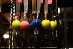 © London News Pictures. 26/10/2013 . London, UK. Balls on leather straps are seen hanging on a stand at the Erotica show at Tobacco Dock in East London on 25 October 2013. The three day event runs from 25 October until 27 October and features stalls selling sex toys and clothes and stage shows of exotic dancing. Photo credit : Vickie Flores/LNP