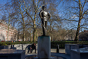 A man talks into his phone below the statue to General Dwight D. Eisenhower outside the US embassy in Grosvenor Square, London.