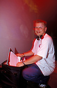 DJ, Timo Mass looking through a record bag