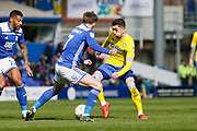 Leeds United midfielder Pablo Hernandez (19) is tackled by Birmingham City midfielder Connor Mahoney  during the EFL Sky Bet Championship match between Birmingham City and Leeds United at St Andrews, Birmingham, England on 6 April 2019.