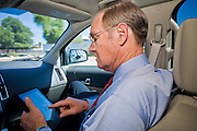 13 OCTOBER 2010 - TUCSON, AZ: Terry Goddard uses an iPad while being driven through Tucson on a campaign trip. The campaign used iPads to stay in touch with Goddard. Terry Goddard spent the day in Tucson campaigning. Goddard lost the election to sitting Governor Jan Brewer, a conservative Republican.     PHOTO BY JACK KURTZ