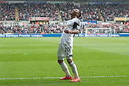 Swansea city's Jonathan De Guzman looks to the heavens as he celebrates scoring his sides 2nd goal .Barclays premier league match , Swansea city v Norwich city at the Liberty stadium in Swansea, South Wales on Saturday 29th March 2014.<br /> pic by Phil Rees, Andrew Orchard sports photography.