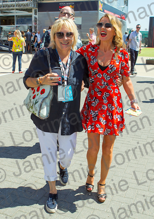 The 2018 Formula 1 F1 Rolex British grand prix, Silverstone, England. Sunday 8th July 2018.<br /> <br /> Pictured: Comedian Ade Edmondson photobombs his wife comedian Jennifer Saunders and spice girl Geri Horner as they walk through the paddock ahead of the race at Silverstone.<br /> <br /> Jamie Lorriman<br /> mail@jamielorriman.co.uk<br /> www.jamielorriman.co.uk<br /> 07718 900288