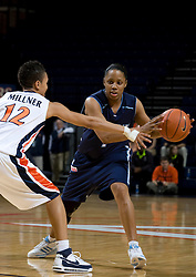 Rhode Island guard Crystal Bellinger (1) is guarded by Virginia guard Britnee Millner (12).  The Virginia Cavaliers women's basketball team defeated the Rhode Island Rams 89-53 at the John Paul Jones Arena in Charlottesville, VA on January 9, 2008.