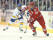 OSU's Peter Boyd brings the puck up ice ahead of LSSU's Domenic Monardo Friday night at Taffy Abel Arena.