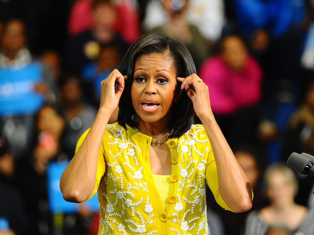 LAURA FONG   First Lady Michelle Obama greets a crowd of 2,000 at Cuyahoga Community College in Cleveland. Mrs. Obama talked about job creation, taking care of veterans, affordable healthcare, and a woman's right to choose.