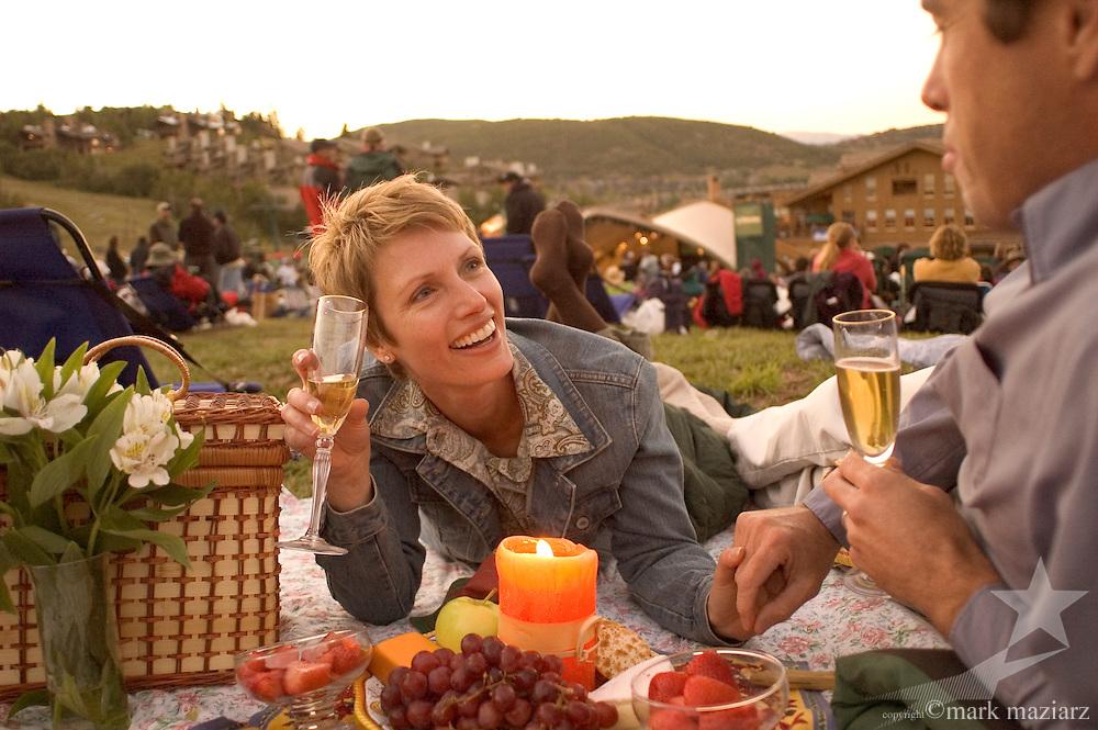 couple having picnic at outdoor concert at Deer Valley Resort, Park City, UT USA