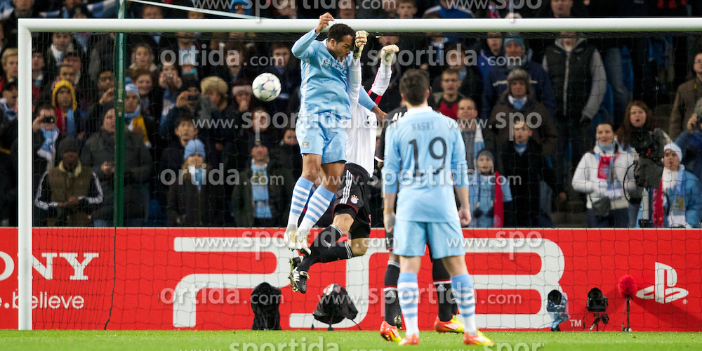 07.12.2011, City of Manchester Stadion, Manchester, ENG, UEFA CL, Gruppe A, Manchester City (ENG) vs FC Bayern München (GER), im Bild Manchester City's Joleon Lescott beats FC Bayern Munchen's goalkeeper and captain Jorg Butt in the air to score the opening goal but the goal was disallowed by the referee during the football match of UEFA Champions league, group A, between Manchester City (ENG) and FC Bayern München (GER), at City of Manchester Stadium, Manchester, United Kingdom on 07/12/2011. EXPA Pictures © 2011, PhotoCredit: EXPA/ Propagand/ David Rawcliff..***** ATTENTION - OUT OF ENG, GBR, UK *****
