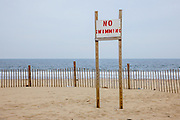 """A sign on the beach in Ashbury Park says """"No Swimming""""."""