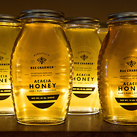 A display of acacia honey at Asheville Bee Charmer, a locally owned company that offers honey and honey-related products at their store on 38 Battery Park Ave in Downtown Asheville, North Carolina.