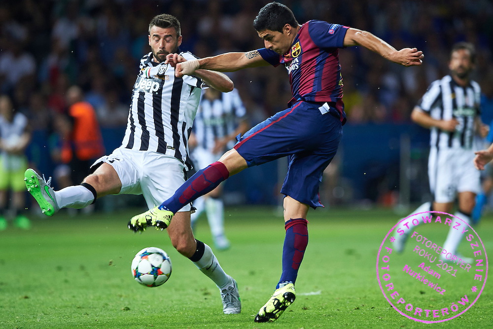 (R) Luis Suarez of FC Barcelona shoots on the goal during the 2014/15 UEFA Champions League Final between Juventus and FC Barcelona at Olympiastadion on June 6, 2015 in Berlin, Germany.<br /> Germany, Berlin, June 6, 2015<br /> <br /> Picture also available in RAW (NEF) or TIFF format on special request.<br /> <br /> For editorial use only. Any commercial or promotional use requires permission.<br /> <br /> Adam Nurkiewicz declares that he has no rights to the image of people at the photographs of his authorship.<br /> <br /> Mandatory credit:<br /> Photo by &copy; Adam Nurkiewicz / Mediasport