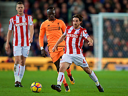 STOKE-ON-TRENT, ENGLAND - Wednesday, November 29, 2017: Liverpool's Sadio Mane and Stoke City's Joe Allen during the FA Premier League match between Stoke City and Liverpool at the Bet365 Stadium. (Pic by David Rawcliffe/Propaganda)