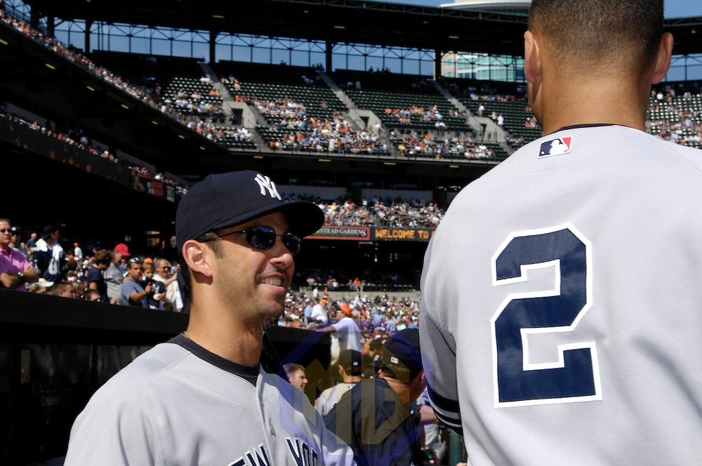 30 September 2007:  New York Yankees catcher and acting manager Jorge Posada (L) chats with New York Yankees shortstop Derek Jeter (2) prior to the start of the game against the Baltimore Orioles.  The Yankees defeated the Orioles 10-4 to end the regular season at Camden Yards in Baltimore, MD.  ****For Editorial Use Only****