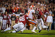 Deshaun Watson is tackled by #56 Tim Williams and #10 Reuben Foster of Alabama during first quarter action of the national championship game at Raymond James stadium in Tampa.