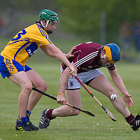Galway's Paul Killeen gets to the slíotar ahead of Clare's Mike O'Malley