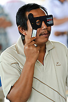 A man being screened for problems with his sight at a mobile clinic, Bali, Indonesia.