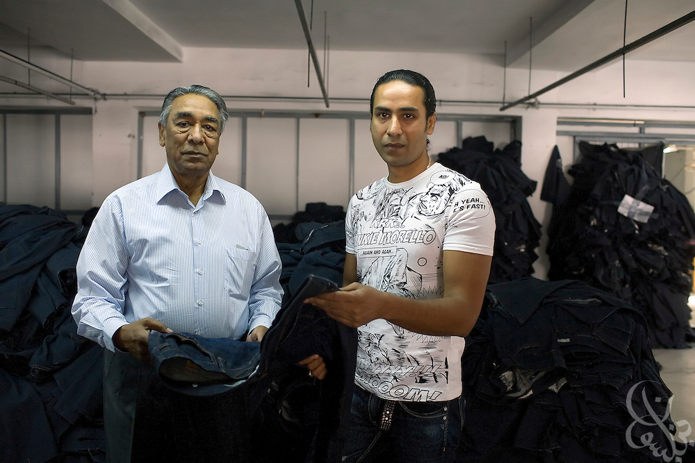 Air Marshal Man Mohan Sinha, chairman of Velocity Apparelz CO (l) inspects the quality of recently manufactured jeans with his son, and CEO of parent company Vogue International Agencies FZE, Siddharth Sinha  October 27, 2008 at the Velocity factory in Ismailia (130 kilometers north of Cairo, Egypt.)  The Sinhas are Indian businessmen who have been operating their jeans company in Egypt since 2001, employing 2700 Egyptian workers while supplying jeans to major companies that include Levis, Target, and Zara.