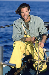 Good looking fisherman on a fishing boat