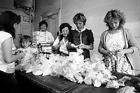 Miners wives and members of womens support groups in Rotherham make up food parcels for striking miners families during the 1984-85 strike. 30 April 1984...&copy; Martin Jenkinson <br />