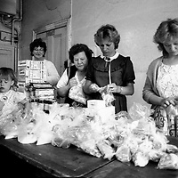 Miners wives and members of womens support groups in Rotherham make up food parcels for striking miners families during the 1984-85 strike. 30 April 1984...© Martin Jenkinson <br />