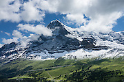 "The Eiger rises above Kleine Scheidegg pass, in the Berner Oberland, Switzerland, the Alps, Europe. The world's longest continuous rack and pinion railway (Wengernalpbahn) goes from Grindelwald up to Kleine Scheidegg and down to Wengen and Lauterbrunnen. From Kleine Scheidegg, Jungfraubahn ascends steeply inside the Eiger to Jungfraujoch, the highest railway station in Europe. UNESCO honors ""Swiss Alps Jungfrau-Aletsch"" on the list of World Heritage Areas."
