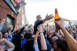 Bristol Rovers Club President Wael Al Qadi joins supporters on Gloucester Road near the stadium to celebrate in the streets after his side  win the match in injury time to secure 3rd place in League 2, back to back promotions and a place in Sky Bet League 1 for 2016/17  - Mandatory byline: Rogan Thomson/JMP - 08/03/2016 - FOOTBALL - Memorial Stadium - Bristol, England - Bristol Rovers v Dagenham & Redbridge - Sky Bet League 2.