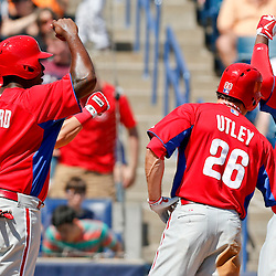 Mar 16, 2013; Tampa, FL, USA; Philadelphia Phillies right fielder Domonic Brown (9) celebrates with teammates  a Chase Utley (26) and Ryan Howard (6) after hitting a three run homerun during the top of the fourth inning of a spring training game against the New York Yankees at George Steinbrenner Field. Mandatory Credit: Derick E. Hingle-USA TODAY Sports