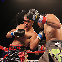 Sammy Valentin fights Gledwin Ortiz during the Top Rank boxing event at Osceola Heritage Park in Kissimmee, Florida on September 23, 2016.