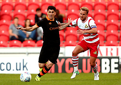 Fernando Forestieri of Sheffield Wednesday goes past James Coppinger of Doncaster Rovers - Mandatory by-line: Robbie Stephenson/JMP - 26/07/2017 - FOOTBALL - The Keepmoat Stadium - Doncaster, England - Doncaster Rovers v Sheffield Wednesday - Pre-season friendly