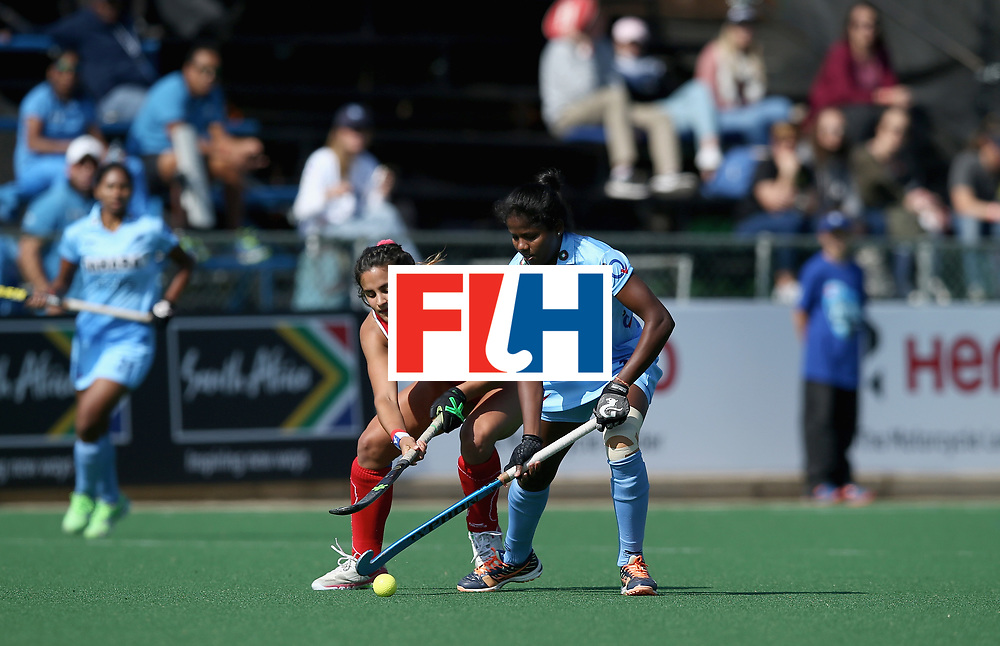 JOHANNESBURG, SOUTH AFRICA - JULY 12: Manuela Urroz of Chile and Namita Toppo of India battle for possession during day 3 of the FIH Hockey World League Semi Finals Pool B match between India and Chile at Wits University on July 12, 2017 in Johannesburg, South Africa. (Photo by Jan Kruger/Getty Images for FIH)