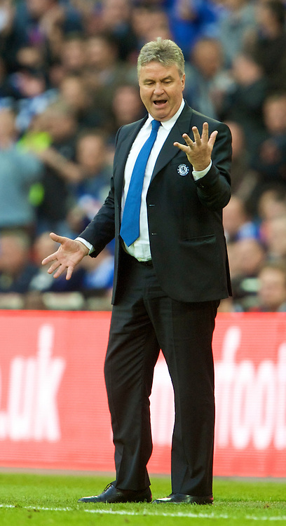 LONDON, ENGLAND - Saturday, April 18, 2009: Chelsea's manager Guus Hiddink celebrates his side's 2-1 victory over Arsenal during the FA Cup Semi-Final match at Wembley. (Photo by: David Rawcliffe/Propaganda)