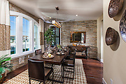 Dining Room with Stacked Stone Wall Accent