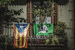 September 10, 2017 - Barcelona, Catalonia, Spain - An 'Estelada' (pro-independence) flag and a banner calling for 'Yes' hang on a balcony on the eve of Catalonia's national day, 'La Diada', 20 days ahead of a planned referendum about the secession from Spain (Credit Image: © Matthias Oesterle via ZUMA Wire)