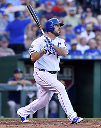 June 20, 2017 - Kansas City, MO, USA - The Kansas City Royals' Mike Moustakas follows through on his 100th career home run, in the second inning against the Boston Red Sox at Kauffman Stadium in Kansas City, Mo., on Tuesday, June 20, 2017. (Credit Image: © John Sleezer/TNS via ZUMA Wire)