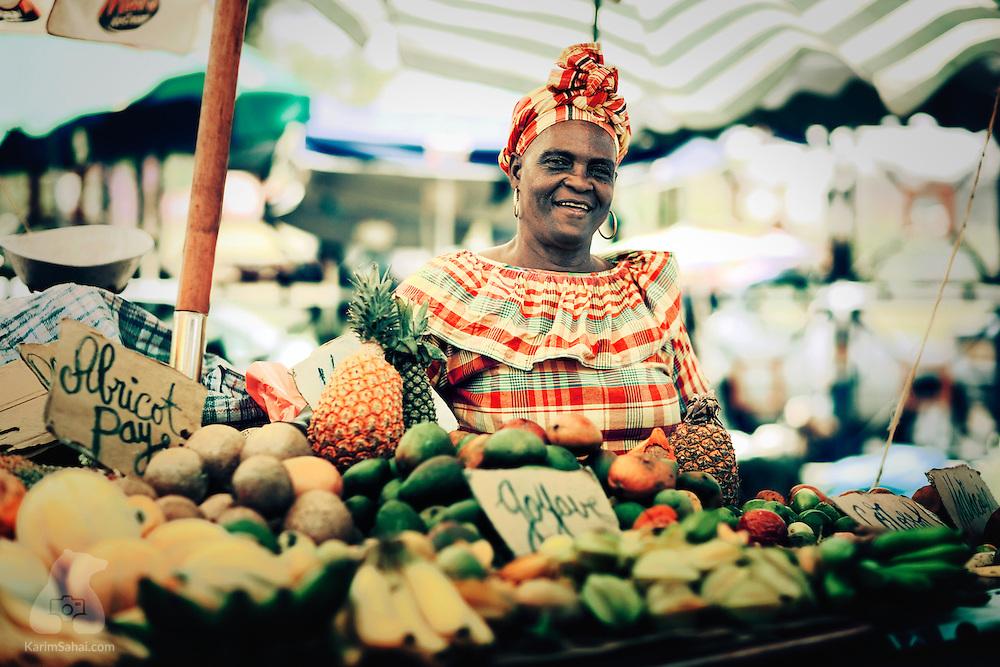Produce vendor wearing traditional 'madras' dress, La Darse market, Pointe-A-Pitre, Guadeloupe