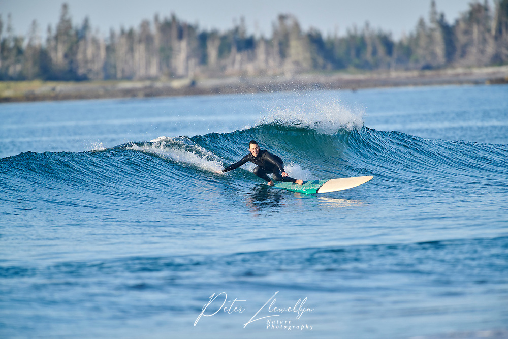Surfers enjoy the morning waves, Cherry Hill Beach, Nova Scotia, Canada