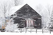 An old barn in a snowy setting in New Hampshire