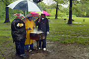 A Heavy rainfall dampened, but did not stop a Memorial Day family barbecue in Orchard Beach in the Bronx.