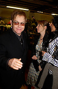 Sir Elton John and Sam Taylor Wood. Party hosted by Isabella Blow in honour of Shaun Leane to celebrate his jewelry collection. Liberty's. London. 8 December 2004. ONE TIME USE ONLY - DO NOT ARCHIVE  © Copyright Photograph by Dafydd Jones 66 Stockwell Park Rd. London SW9 0DA Tel 020 7733 0108 www.dafjones.com