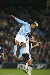 MANCHESTER, ENGLAND - WEDNESDAY, JANUARY 4th, 2006: Manchester City's Sylvain Distin and Tottenham Hotspur's Mido during the Premiership match at the City of Manchester Stadium. (Pic by David Rawcliffe/Propaganda)