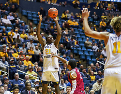 Nov 28, 2018; Morgantown, WV, USA; West Virginia Mountaineers forward Wesley Harris (21) shoots during the second half against the Rider Broncs at WVU Coliseum. Mandatory Credit: Ben Queen-USA TODAY Sports