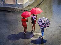 SANTIAGO DE CUBA, CUBA - CIRCA JANUARY 2020: Pedestrians walking in Santiago de Cuba during a rainy day.