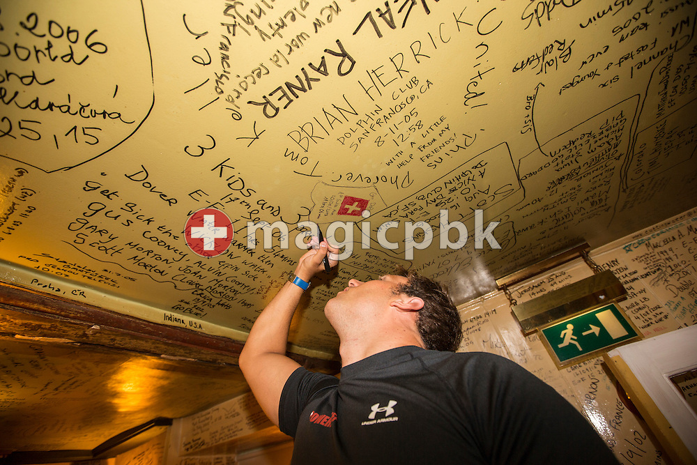 Gino Deflorian of Switzerland, who crossed the English Channel in 11 Hours 6 Minutes from Samphire Hoe (Great Britain) to Cap Gris Nez (France) on Tuesday, Aug. 20, 2013, writes his record on the ceiling of The White Horse Inn - one of the town's oldest residences dating from 1365 - in Dover, Great Britain, Wednesday, Aug. 21, 2013. Gino Deflorian is the first Swiss male swimmer who successfully swims the English Channel and the third Swiss. (Photo by Patrick B. Kraemer / MAGICPBK)