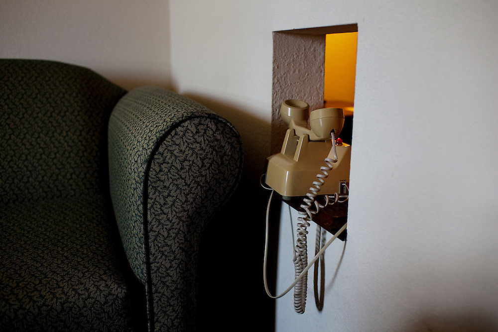 A phone sits upside down in its cradle in a room at the Best Western Hotel on Highway 82 in Greenwood, Mississippi on September 24, 2010.