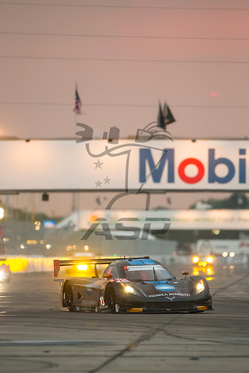 Sebring, FL - Mar 19, 2015:  The Wayne Taylor Racing Corvette DP, Chevrolet, Corvette, Prototype races through the turns 12 Hours of Sebring at Sebring Raceway in Sebring, FL.