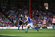 Ryan Fraser scoring Ipswich second goal during the Sky Bet Championship match between Brentford and Ipswich Town at Griffin Park, London, England on 8 August 2015. Photo by Matthew Redman.