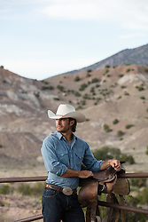 rugged cowboy on a ranch at sunset