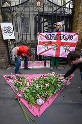 © Licensed to London News Pictures. 12/04/2017. London, UK. Hundreds of activists gather outside the Russian Embassy in central London in protest against the treatment of homosexuals in Chechnya.  Protesters brought symbolic pink flowers to be laid in a triangle outside the gates.  Independent newspaper Novaya Gazeta has reported the arrest of members of the gay community and their being taken to 'concentration camps'. Photo credit : Stephen Chung/LNP