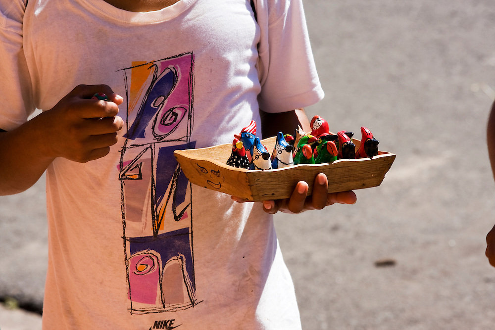 A local boy sells typical Nicaraguan pottery in front of the Cathedral.